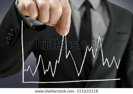 Male hand pulling line chart upwards. Concept of economy recovery. - stock photo