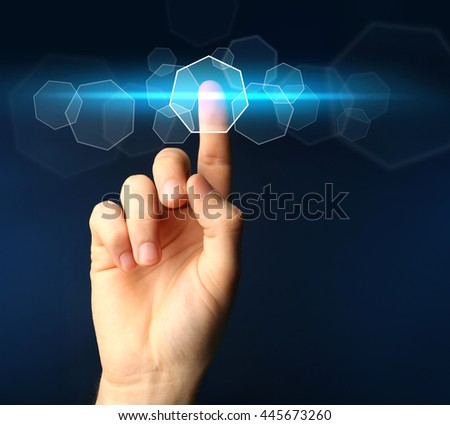 Male hand pushing a button on virtual screen