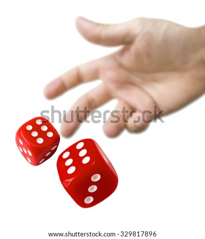 male hand rolling red dice isolated stock photo royalty free