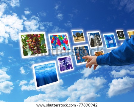 Male hand selecting images multimedia information flow - stock photo