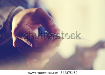 Male hand showing credit card.Vintage or pastel effect photo. - stock photo
