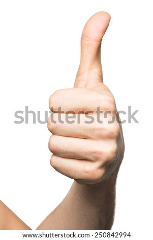 Male hand showing thumbs up sign against white background - stock photo