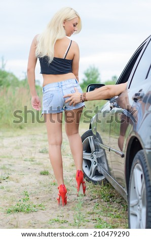 Male hand slaps the girl's ass. - stock photo
