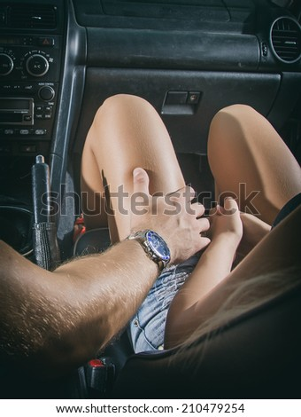 Male hand touches the female knee. - stock photo