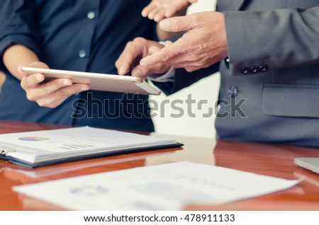 male hand use pen pointing at tablet discussion at office