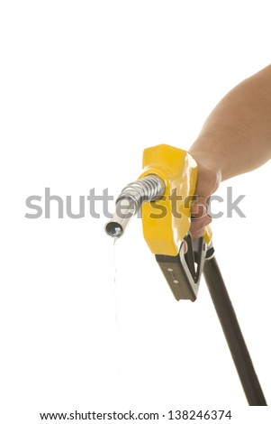 Male hand wasting gas with yellow pump isolated on white