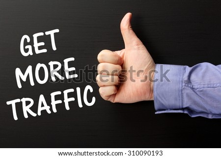 Male hand wearing  business shirt giving the thumbs up sign for the phrase Get More Traffic as a reminder that online retailers need marketing to attract customers