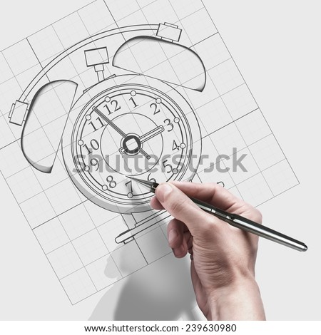 male hand with pen. engineer working on cad concept Old-fashioned alarm clock.  - stock photo