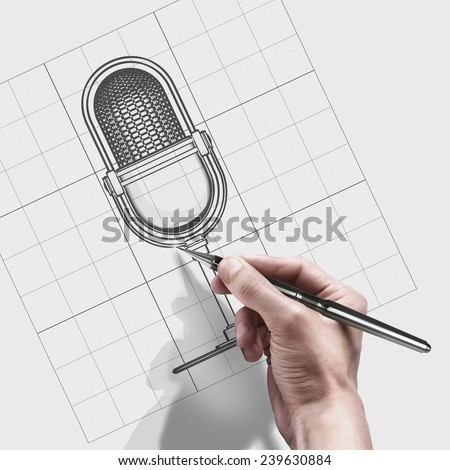 male hand with pen. engineer working on cad concept Retro microphone.  - stock photo