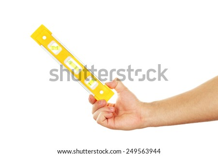 Male hand with ruler level isolated on white