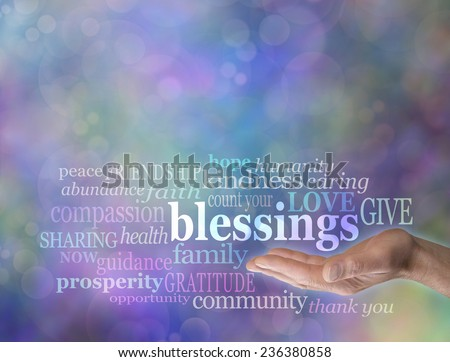 Male hand with the word 'blessings' floating above surrounded by words relevant to Count Your Blessings in a word cloud on a blue bokeh background                                - stock photo