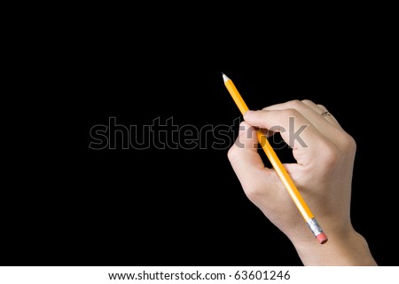 male hand writing by pencil on black background - stock photo