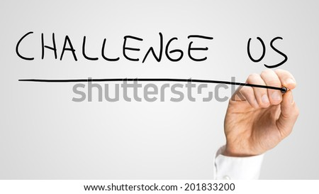 Male hand writing Challenge us on virtual screen.