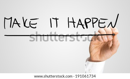Male hand writing Make it happen on virtual screen. - stock photo