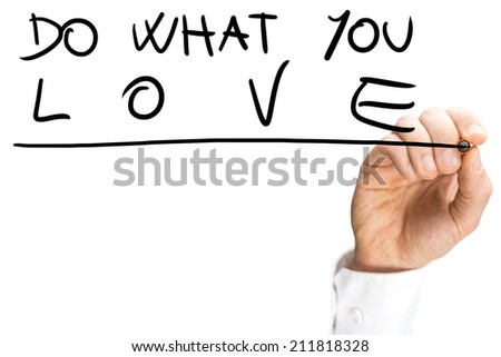 Male hand writing on a virtual transparent screen an inspirational message urging to do what you love, with copy space on white. - stock photo