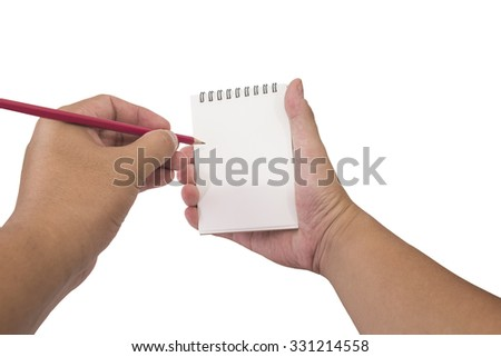 Male hand writing to notebook on white background