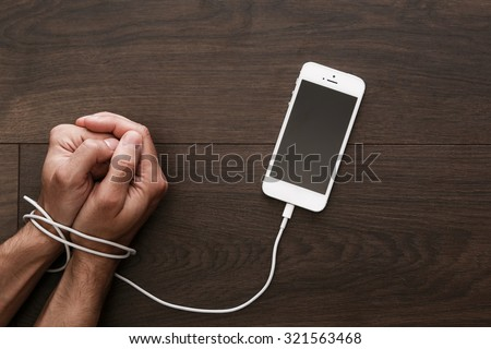 Male hands and smartphone. Addiction to internet and social networks - stock photo