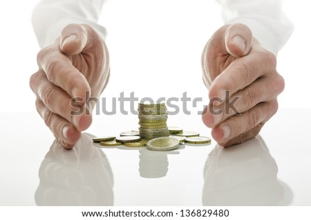 Male hands around Euro coins. Concept of solution to financial crisis. - stock photo