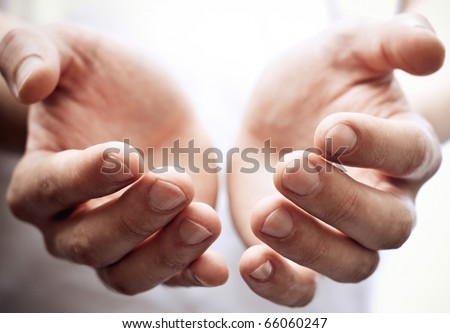 Male hands as if holding something. Focus on finger-tips - stock photo
