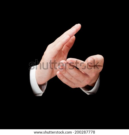 Male hands clapping isolated over black background - stock photo
