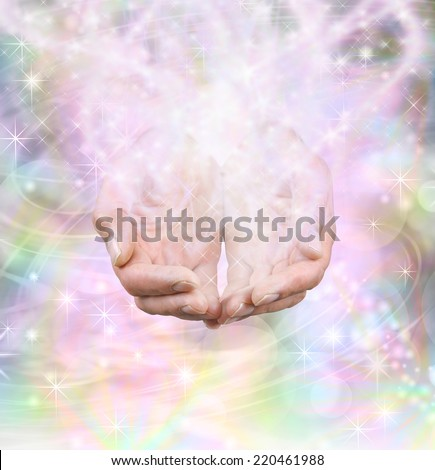 Male hands cupped emerging from swirling rainbow colored background with energy formation and sparkles - stock photo
