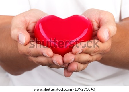 Male hands giving red heart