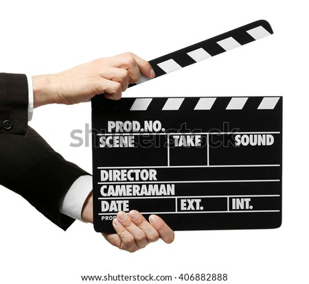Male hands holding a movie clapperboard, on white background - stock photo