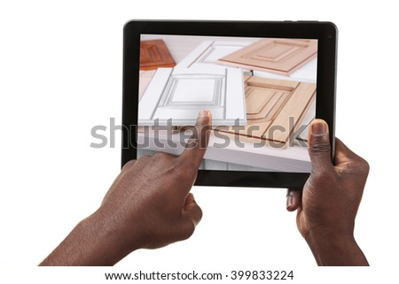 Male hands holding a tablet isolated on white - stock photo