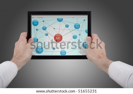 male hands holding a touchpad pc and surfing in the social network