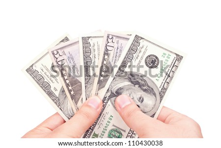 Male hands holding American Dollar-bills fan, with white background - stock photo