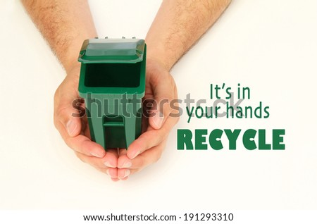 Male hands holding an open garbage can, it's in your hands recycle.  - stock photo