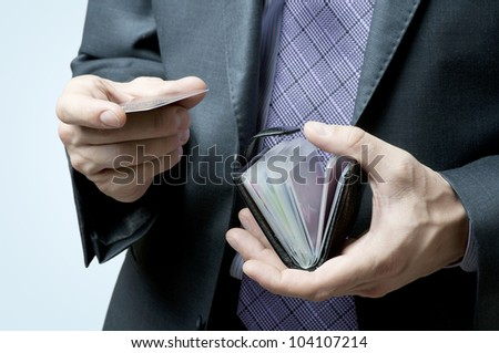 Male hands holding credit cards - stock photo