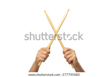 Male hands holding drum sticks - stock photo