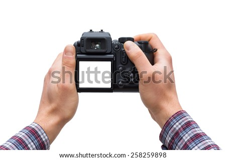 Male hands holding DSLR camera isolated on white - In this photo the logos, brand, or anything that can bring to a particular object has been deleted to be 100% commercial. - stock photo