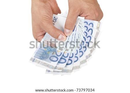 male hands holding european money - stock photo