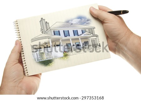 Male Hands Holding Pen and Pad of Paper with House Drawing Isolated on a White Background. - stock photo