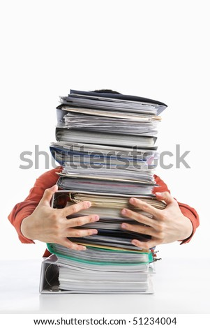 Male hands holding pile of paperwork, over white background