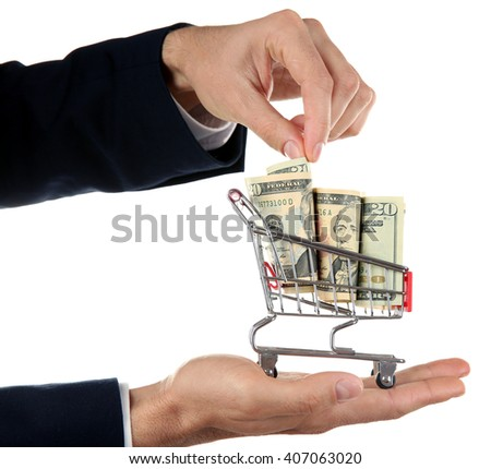 Male hands holding supermarket trolley with dollar banknotes, isolated on white