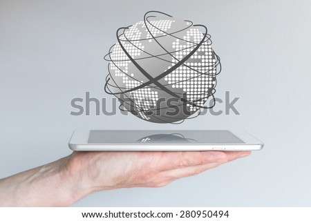 Male hands holding tablet or large smart phone in order to connect to the world wide web. Concept of mobile computing and the internet. Visualization with world and connecting lines. - stock photo