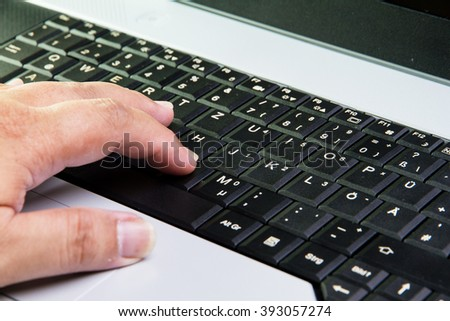 male hands on a notebook keyboard typing
