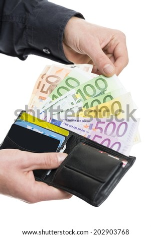 Male hands pulling out European banknotes from the wallet isolated on white. Shallow depth of field. - stock photo