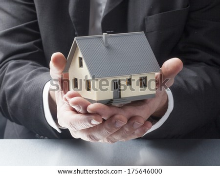male hands showing a house - stock photo