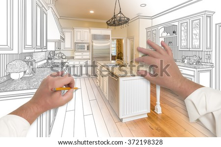 Male Hands Sketching with Pencil A Custom Kitchen with Photo Showing Through. - stock photo