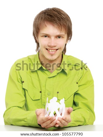 Male hands taking care of paper people - stock photo
