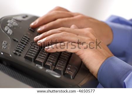 male hands type on keyboard close up - stock photo