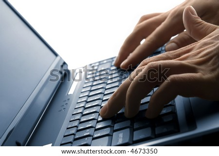 male hands typing on a laptop close up