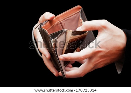 male hands with empty wallet isolated on black - stock photo