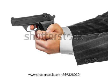 Male hands with gun isolated on white background - stock photo