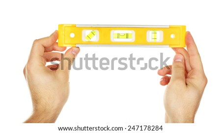 Male hands with ruler level isolated on white - stock photo