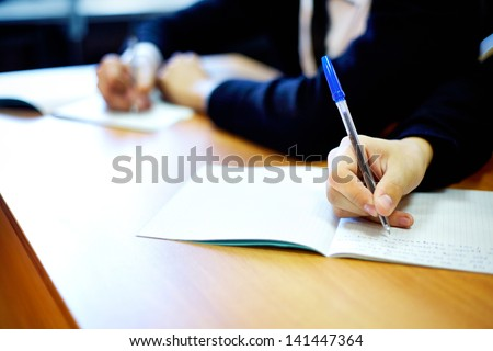 Male hands writing task while examination - stock photo